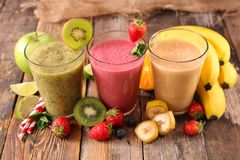 Glasses of smoothie. On wood Royalty Free Stock Photography