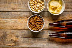 Glasses, snacks, beer for whatchig film on wooden background top view space for text Royalty Free Stock Photo