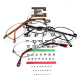 Glasses on snellen eye sight chart test. Background Royalty Free Stock Photos