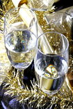 Glasses of sparkling wine. Glasses of champagne on black background with decorations Stock Photos