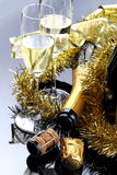 Glasses of sparkling wine. Glasses of champagne with bottle on black background with decorations Royalty Free Stock Image