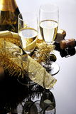 Glasses of sparkling wine. Glasses of champagne with bottle on black background with decorations Stock Images