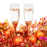 Glasses of sparkling wine and gold Xmas bauble Stock Photos
