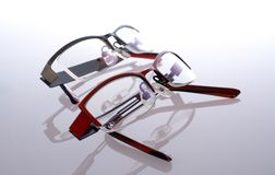 Glasses, specs, spectacles. Two pairs of spectacles on white with reflection Stock Images
