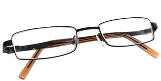 Glasses spectacles. Glasses or spectacles folded up, academic, vision or clever royalty free stock photos
