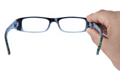 Glasses Spectacles Focusing hand Isolated. Male hand holding glasses or spectacles focusing isolated white Stock Image