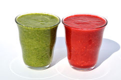 Glasses of spinach and  raspberry smoothies. On white background Stock Photo