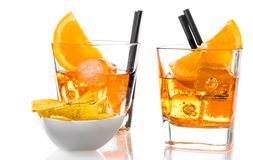 Glasses of spritz aperitif aperol cocktail with orange slices and ice cubes near tacos chips Stock Image