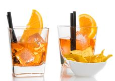 Glasses of spritz aperitif aperol cocktail with orange slices and ice cubes near tacos chips Royalty Free Stock Images