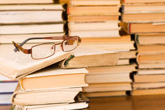 Glasses on stack of books Stock Photo