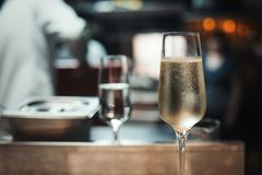 2 glasses with sparkling champaign with bubbles stand on the table in the restaurant royalty free stock photo