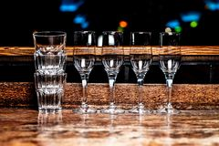 Glasses standing in a row royalty free stock photography