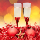 Glasses star red Xmass baubles on blur background Royalty Free Stock Photography