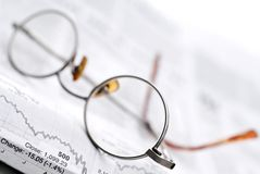 Glasses on a stock report Royalty Free Stock Image