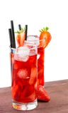 Glasses of strawberry cocktail with ice on old wood table Stock Image