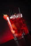 Glasses of strawberry cocktail with ice on wood table Royalty Free Stock Images
