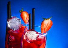 Glasses of strawberry cocktail with ice on wood table and space for text Royalty Free Stock Images