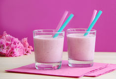 Glasses of strawberry milkshake. Healthy smoothie prepared as milk fruity cocktail. Strawberry coctail made from fresh strawberries. Healthy smoothie drink Stock Photos
