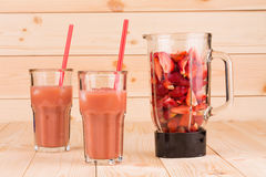 Glasses of strawberry smoothie Stock Photos