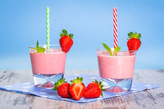 Glasses of strawberry smoothie Royalty Free Stock Photos