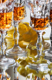 Glasses with strong liquor. Crystal glasses with strong liquor Royalty Free Stock Images