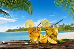 Glasses of summer ice tea drink on beach Stock Image