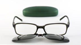 Glasses with sunglasses magnetic clip next to its case. Eyeglasses with protection lenses for sun Stock Photo