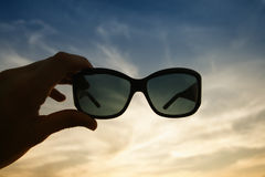 Glasses and sunset Stock Photo