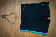 Glasses and Swimming trunks. On wooden background Royalty Free Stock Images