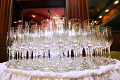 Glasses on table. Many crystal glasses on white table Stock Photography