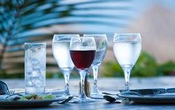 Glasses on a table. Wine and water glasses on a table stock images