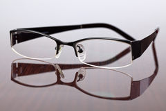 Glasses on table. The glasses on wooden table royalty free stock images