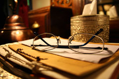 Glasses on a table. Dim lighting of some spectacles Royalty Free Stock Image