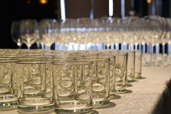 Glasses on the table artfully arranged. With special light Royalty Free Stock Images