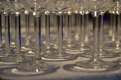Glasses on the table artfully arranged with special light Royalty Free Stock Images