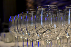 Glasses on the table artfully arranged with special light Royalty Free Stock Photo