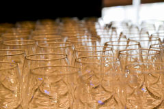 Glasses on the table artfully arranged. With yellow special light Stock Photography