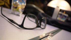 Glasses on Table. Black Glasses lying on table stock photo