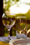 Glasses on table in cafe Stock Images