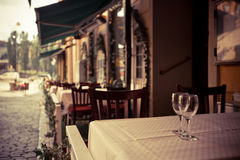 Glasses on the table. Focus on glasses. Glasses on the table. Street cafe. Focus on glasses Royalty Free Stock Images