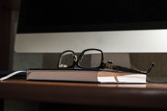Glasses on the table. Points on the office Desk Royalty Free Stock Photo