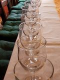 Glasses on the table. A row of red wine glasses on the table Royalty Free Stock Image
