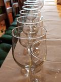 Glasses on the table. A row of red wine glasses on the table Royalty Free Stock Images