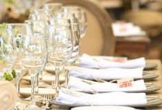 Glasses in a table set for a reception, party event or wedding c Stock Photos