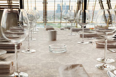 Glasses at table with tablecloth in restaurant Stock Photo