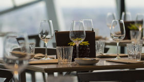 Wine glasses on the restaurant table. Three wine glasses on the table in one of the London restaurants Stock Photos