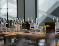 Glasses on the table. Three wine glasses on the table in one of the London restaurants Stock Images