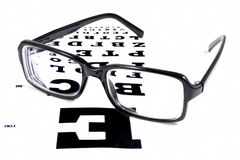 Glasses with TABLE VERIFICATION OF VIEW Royalty Free Stock Image
