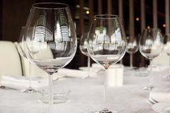 Glasses at table with white tablecloth Royalty Free Stock Photography