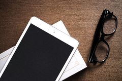Glasses and a tablet Royalty Free Stock Image